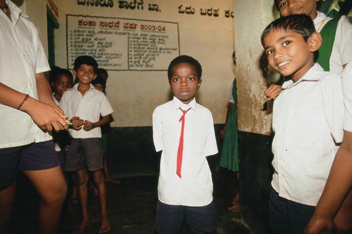 Siddi school boy (centre) in Yellapur, India.