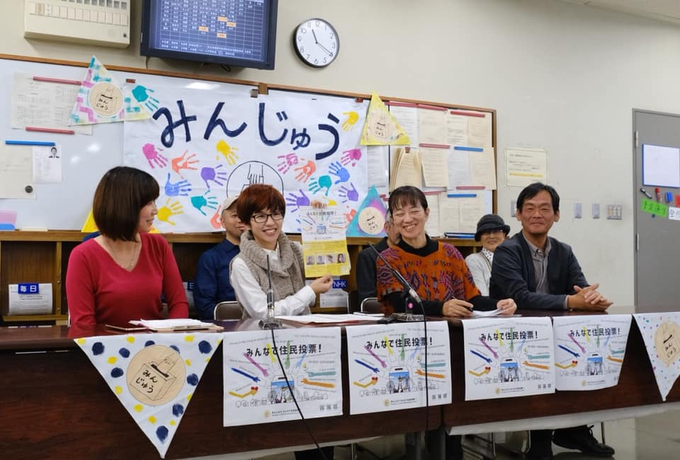 Jin Woong Kwak (far right) at a press event in Osaka on the right of ethnic Koreans and other groups to participate in a local referendum.