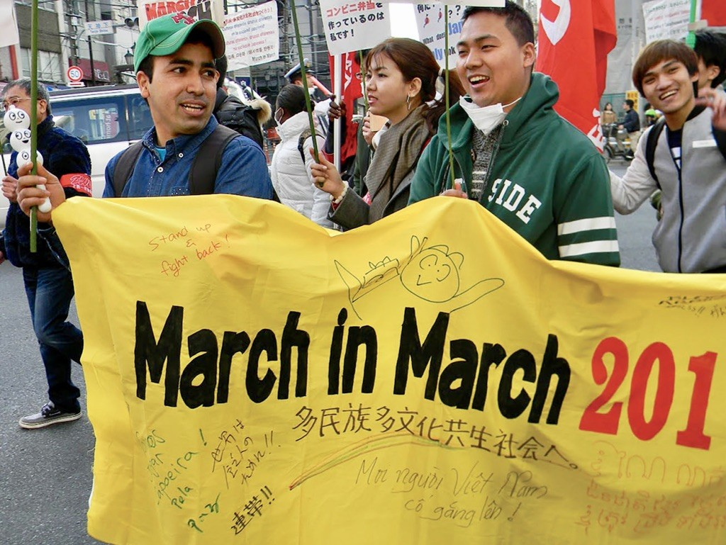 Activists taking part in a demonstration for foreign workers' rights.
